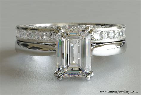 emerald cut solitaire engagement ring with