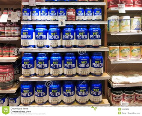whey protein jars on store shelf editorial stock image