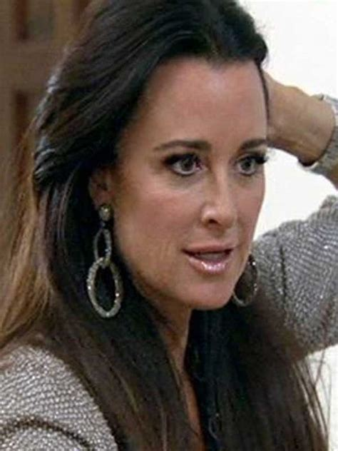 what earrings do the real houses wifes of beverly hills wear kyle richards clip earrings and swarovski crystals on