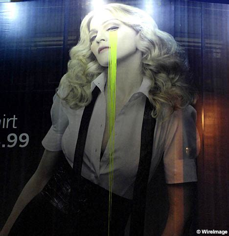 Madonna For Hm Billboard Vandalized by Graffiti Vandals Make Madonna Weep In Poster Daily Mail