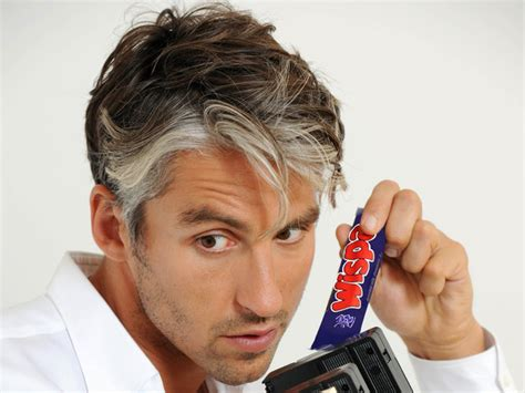 black man with grey streak of hair george lamb launches time well mis spent foundation