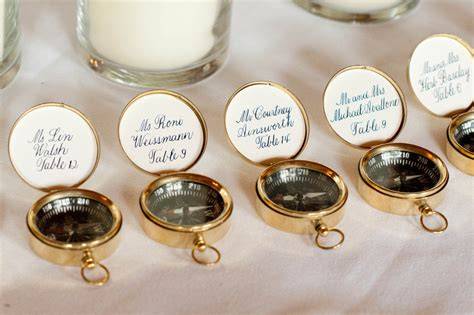 nautical themed real wedding compass guest favors escort cards   OneWed.com