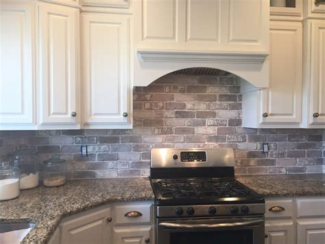 photos of backsplashes in kitchens love brick backsplash in the kitchen easy diy install