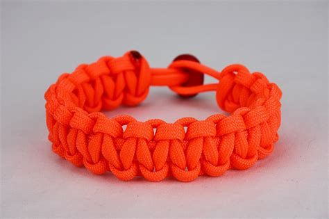 neon orange paracord bracelet unity band with red button back