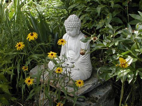 flower garden statues in praise of buddha gardens
