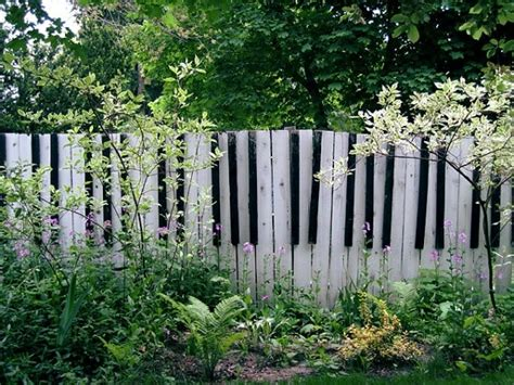 awesome wood material creating unique fence ideas designed with stripes style covering creative garden fence ideas one decor