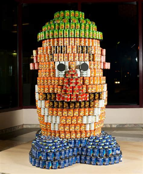 how to build a canned food sculpture canstruction s intricate food cans sculptures fight hunger