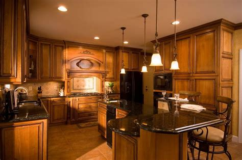 tuscan style raised panel cherry cabinetry pendant lights