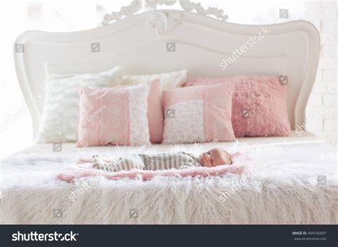 bright morning pillow top beds newborn baby sleeping on big bed stock photo 409746097