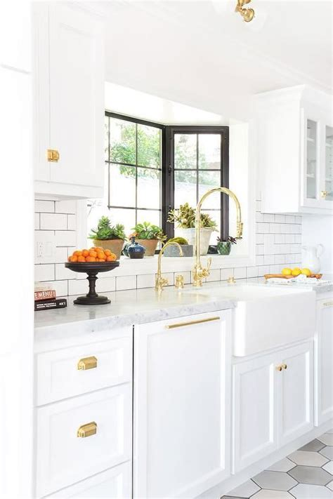 white kitchen cabinets with gold hardware white and gold kitchen features white cabinets adorned