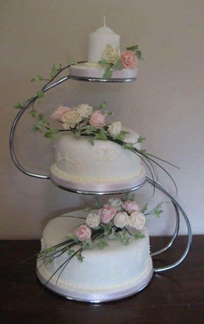 Two tier wedding cake displayed on 'S' shaped wedding cake