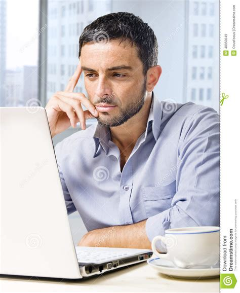 attractive computer attractive businessman working on computer at office desk