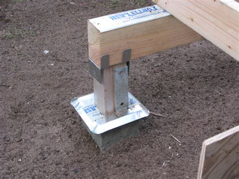 post with cement footing carpentry deck support posts concrete or post base pro