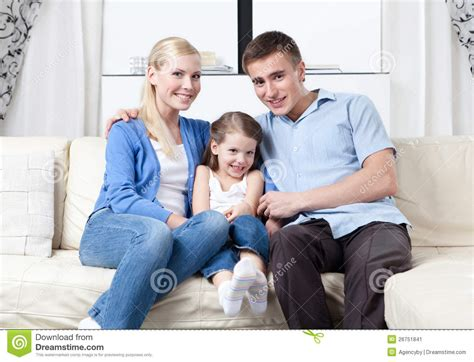 family sofa happy family hug each other on the sofa stock image