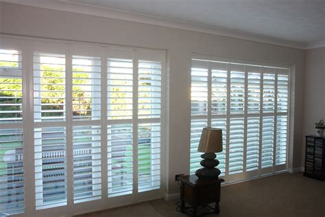drapes with plantation shutters curtains or plantation shutters decorate the house with
