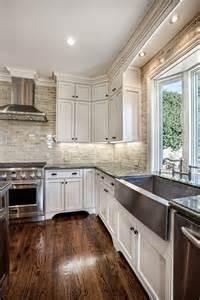 white cabinets hardwood floors and that backsplash