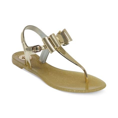 gold jelly sandals bcbgeneration demee jelly sandals in metallic lyst