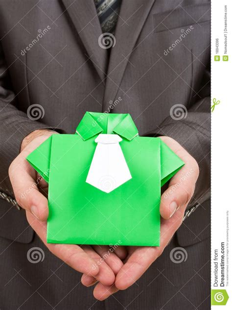 Origami Holding - origami suit in royalty free stock image image
