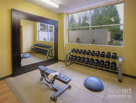 weight room with mirror and bench photograph by andersen ross