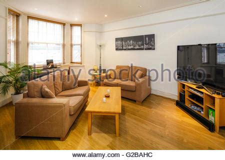 free room tone large living room with 5 windows and light parquet flooring view of stock photo royalty free