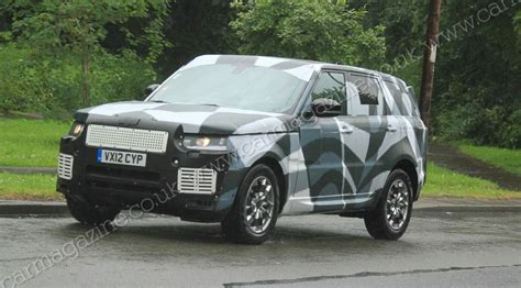 new land rover defender spy shots range rover sport 2013 spy shots by car magazine
