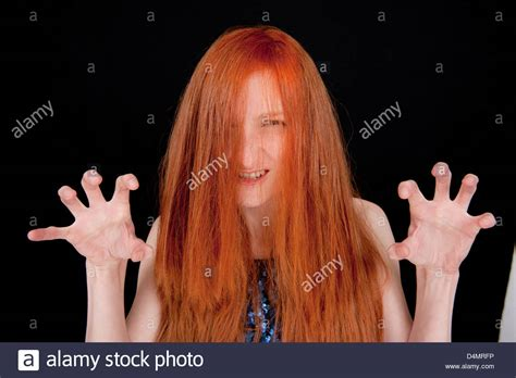how to cover red hair girl with long red hair covering her face and wearing