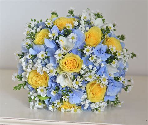 flowers to go yellow wedding bouquets yellow roses blue