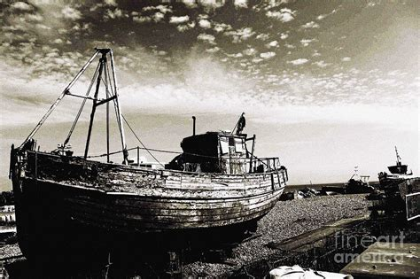 pebble art fishing boat the old fishing boat on pebble beach photograph by callan