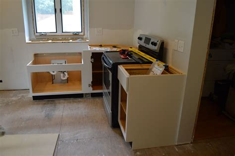 how to install wall cabinets without studs how to hang a kitchen cabinet without stud
