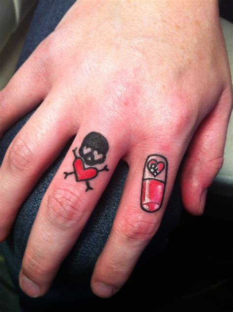 finger tattoos skull and pill tattoos i