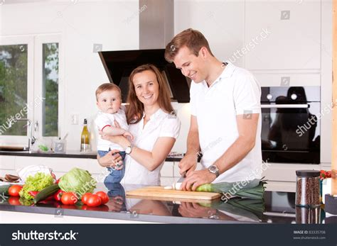 Happy In The Kitchen A Dinner A Signing happy family home kitchen cooking stock photo