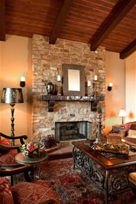mediterranean living room with carpet stone fireplace in 1000 images about stone fireplaces on pinterest