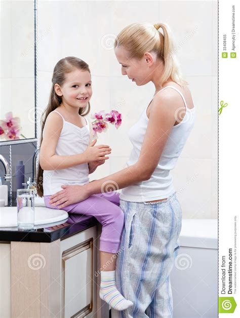 mom in bathroom mother and daughter talk in bathroom royalty free stock