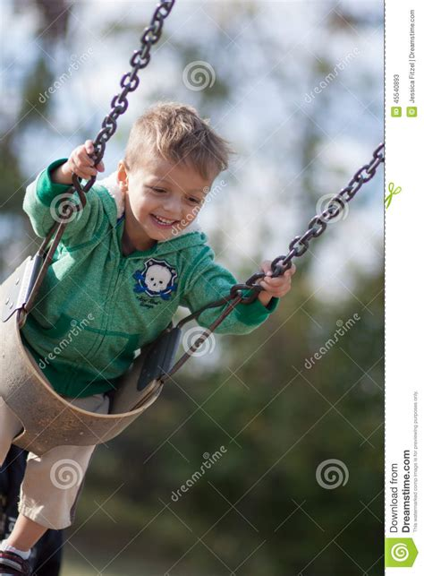 baby fell out of swing boy swinging stock photo image 45540893