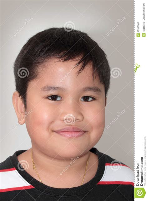 mixed race boys cuts portrait of a smiling little mixed race boy stock photo