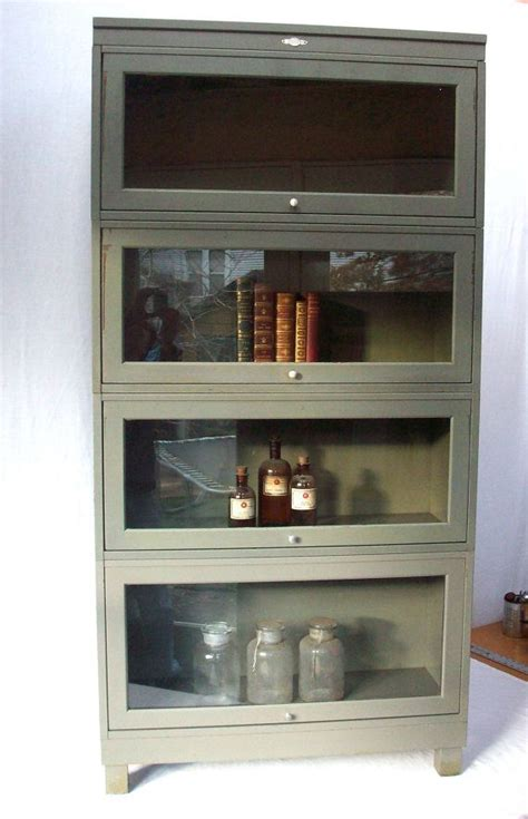 amazing Dining Room Wall Colors #3: metal-barrister-bookcase-with-one-coloumn-and-4doors-for-books-bottles-and-things-near-white-wall.jpg