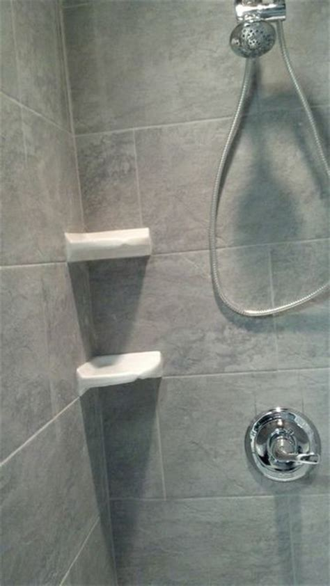 shower with white corner shelves traditional