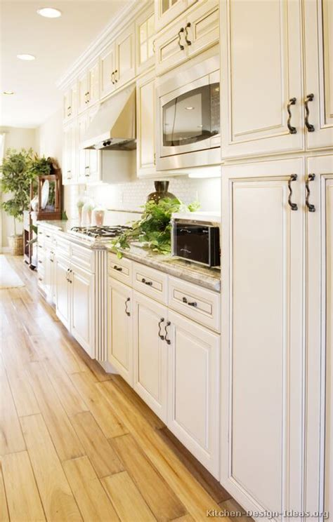 Wood Floor Ideas For Kitchens Antique White Kitchen With Wood Floors And An Island Sink