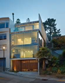 garage and 3rd floor deck connects glass home to slope