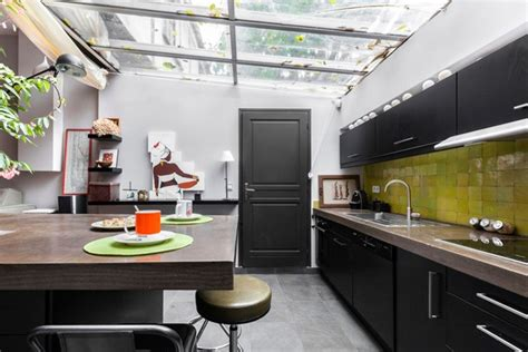 monochrome modern green tiles glass roof kitchen