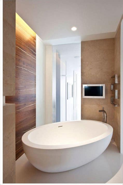 Small Bathroom Designs With Tub bathroom cream wall tile with oval stand alone bathtub on