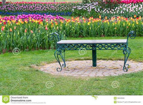 bench stockists elderly couple sitting on a bench in a flower garden at a