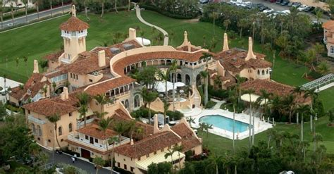 donald trump house florida thousands demand charities call off galas at trump s mar a