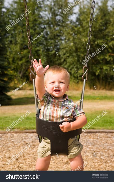 swing for 1 year old a portrait of a cute one year old baby boy on a swing
