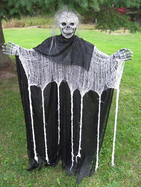 48 creepy outdoor halloween decoration ideas 48 quot hanging skeleton scary reaper ghoul halloween decor