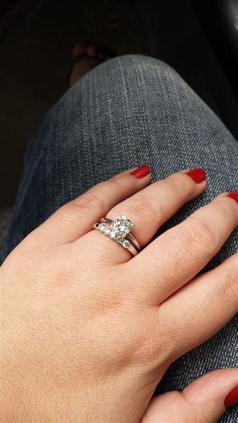 Princess cut solitaire with round diamond wedding band?