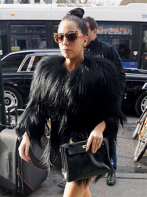 Sling Bag Lagy Gaga this week headed to sundance and couture shows check out their bags purseblog