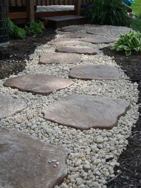 laying gravel in backyard lay a stepping stones and path combo to update your