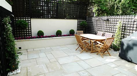 patio beds sandstone paving patio raised beds classic modern planting