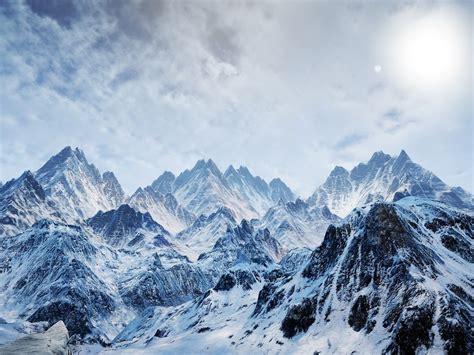 sun mountains mountainscapes snow landscapes wallpaper